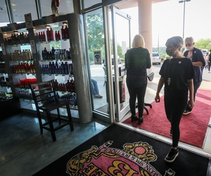 Employees and customers walk in to Three-13 Salon, Spa & Boutique on Friday, April 24, 2020, in Marietta, Ga.