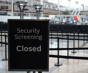 A sign stands outside the ropes of the closed north security checkpoint in the main terminal at Denver International Airport Thursday, April 23, 2020, in Denver.