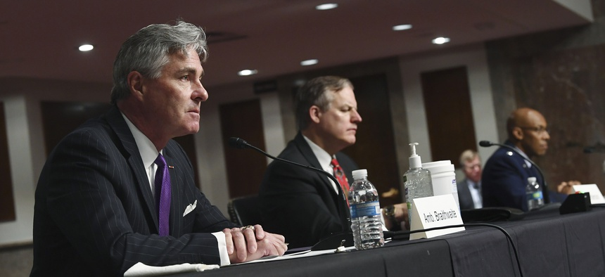 Kenneth Braithwaite, left, nominated to be Navy Secretary, James Anderson, nominated to be Deputy Under Secretary of Defense for Policy and Gen. Charles Q. Brown, Jr., right, nominated to be Air Force Chief of Staff, testify to senators on May 7, 2020.