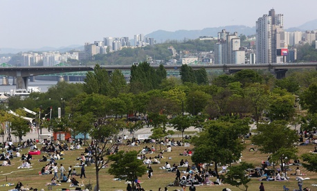 People at a public park on the Han River in Seoul, South Korea, Thursday, April 30, 2020.