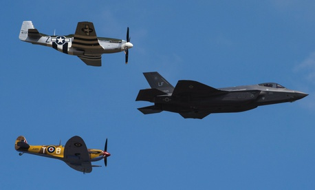 A U.S. Air Force F-35 Lightning II, P-51D Mustang and VS Spitfire perform a heritage flight during the 2018 Royal International Air Tattoo at RAF Fairford, England, July 14, 2018.