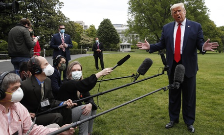 President Donald Trump speaks with reporters on the South Lawn of the White House as he departs on Marine One, Thursday, May 14, 2020, in Washington.