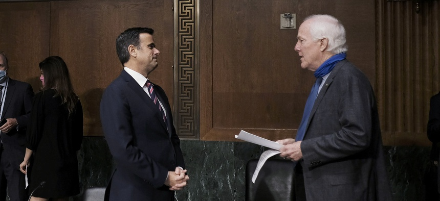 Rep. John Ratcliffe, R-Texas, talks with Sen. John Cornyn, R-Texas at the top of a Senate Intelligence Committee nomination hearing on Capitol Hill in Washington, Tuesday, May. 5, 2020. The panel is considering Ratcliffe's nomination.