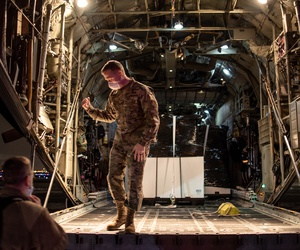 U.S. Air Force Brigadier General Richard R. Neely, the Adjutant General of the State of Illinois, briefly meets with the crew on a C-130H Hercules aircraft assigned to the 182nd Airlift Wing, Illinois Air National Guard.