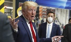 In this May 21, 2020 photo, President Donald Trump holds a face mask in his left hand as speaks during a tour of Ford's Rawsonville Components Plant that has been converted to making personal protection and medical equipment in Ypsilanti, Mich.