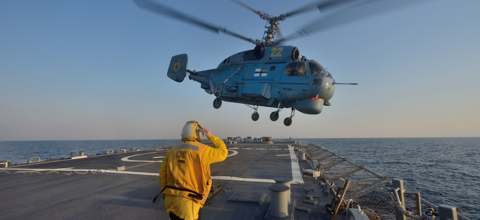 Boatswain's Mate 3rd Class Jennifer Sahley salutes as a Ukrainian navy Ka-27 Helix helicopter takes off from the Arleigh Burke-class guided-missile destroyer USS Ross (DDG 71) during exercise Sea Breeze 2014 in the Black Sea.