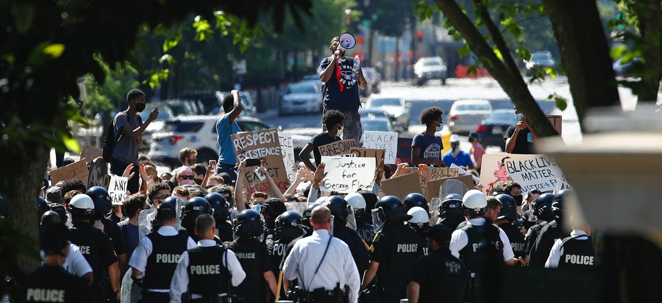 Protesters gather in front of a line of Uniformed U.S. Secret Service as demonstrators gather to protest the death of George Floyd, near the White House, Saturday, May 30, 2020, in Washington.