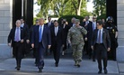 After tear gassing lawful protestors, President Donald Trump departs the White House with Defense Secretary Mark Esper and Joint Chiefs Chairman Gen. Mark Milley for a photo op at St. John's Church, Monday, June 1, 2020, in Washington.