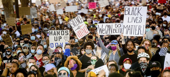 Several thousand demonstrators gather in Oakland, Calif., on Monday, June 1, 2020, to protest the death of George Floyd, who died after being restrained by Minneapolis police officers on May 25.