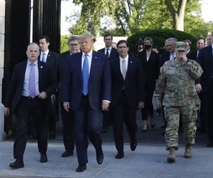 Chairman of the Joint Chiefs Gen. Mark Milley and Defense Secretary Mark Esper accompany President Donald Trump from the gates of the White House to visit St. John's Church across Lafayette Park Monday, June 1, 2020, in Washington.