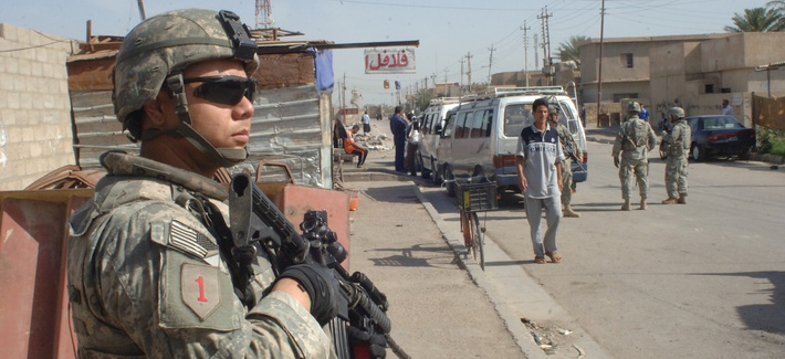 Pvt. Anthony Salazar, Bravo Company, 1st Battalion, 28th Infantry Regiment, 4th Brigade Combat Team, 1st Infantry Division pulls security during a patrol in the Furat area of Baghdad, Iraq on May 8, 2007