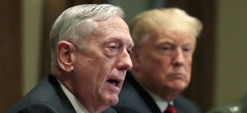 In this Oct. 23, 2018 file photo, Defense Secretary Jim Mattis speaks beside President Donald Trump, during a briefing with senior military leaders in the Cabinet Room at the White House in Washington.