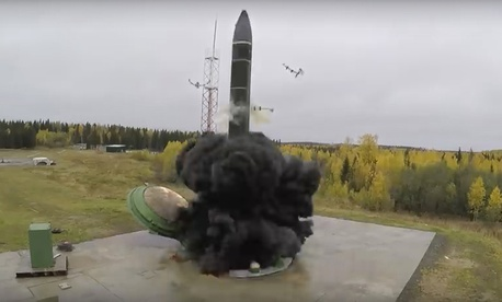 In this photo taken from undated footage distributed by Russian Defense Ministry Press Service, an intercontinental ballistic missile lifts off from a silo somewhere in Russia.
