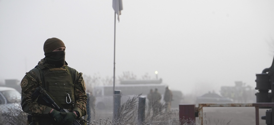 A Ukrainian soldier guards an area during war prisoners exchange near Odradivka, eastern Ukraine, Sunday, Dec. 29, 2019.