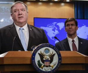 Secretary of State Mike Pompeo speaks as Defense Secretary Mark Esper listens, during a joint briefing, Thursday, June 11, 2020 at the State Department in Washington, on an executive order signed by President Donald Trump aimed at the International Crimin