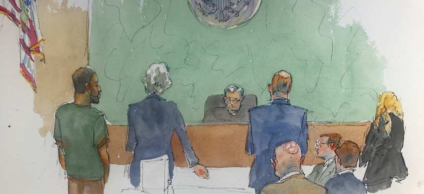 In this courtroom drawing, Najibullah Zazi, left appears at federal court in the Brooklyn borough of New York, Thursday, May 2, 2019, where he was sentenced to ten years in prison for plotting to bomb the New York subway system in 2009.