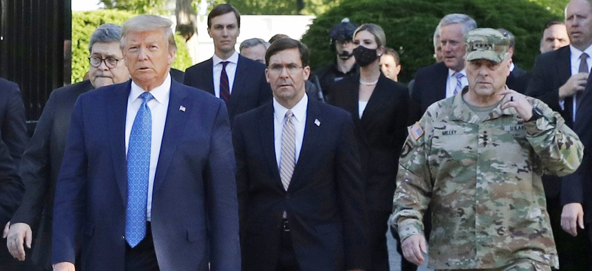 President Donald Trump leaves the White House for a photo op. Walking behind Trump, right, is Gen. Mark Milley, chairman of the Joint Chiefs of Staff.