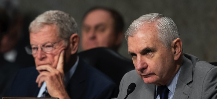 Senate Armed Services Committee Chairman Jim Inhofe, of Oklahoma, listens as Ranking Member Sen. Jack Reed, D-R.I., speaks during a hearing of the Senate Armed Services Committee on Dec. 3, 2019 in Washington.