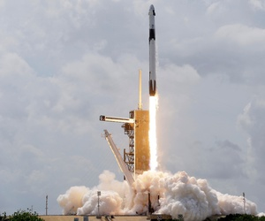 A SpaceX Falcon 9, with NASA astronauts Doug Hurley and Bob Behnken in the Crew Dragon capsule, lifts off from Pad 39-A at the Kennedy Space Center in Cape Canaveral, Fla., on May 30.