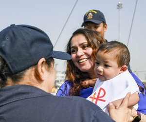 U.S. Navy Chief Personnel Specialist Aracely Sanchez holds Lukas Vaughn T. Copple on USS Gladiator (MCM 11) after a baptism ceremony held on the ship in port in Manama, Bahrain.
