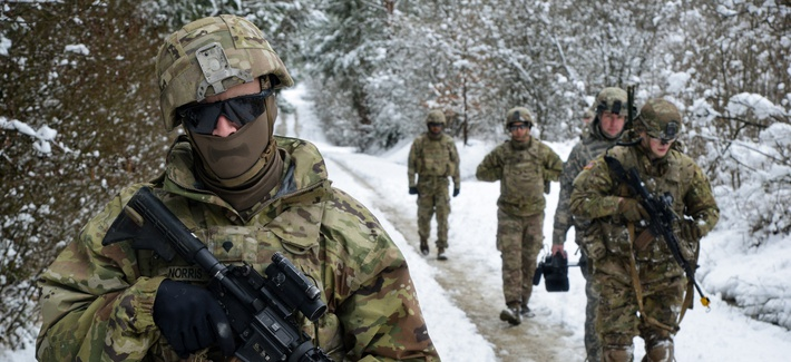 Army Spc. Paul Norris leads a group of soldiers conducting scouting operations at the Grafenwoehr Training Area, Germany, Feb. 28, 2020.