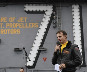 In this Nov. 15, 2019, photo U.S. Navy Capt. Brett Crozier, commanding officer of the aircraft carrier USS Theodore Roosevelt (CVN 71), addresses the crew