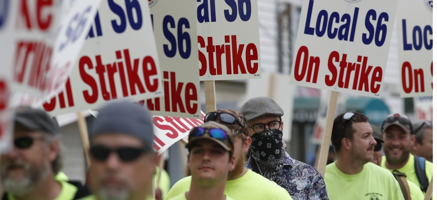 Striking shipbuilders picket outside an entrance to Bath Iron Works, Monday, June 22, 2020, in Bath, Maine.