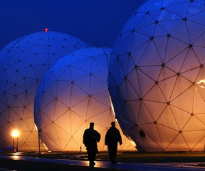 Boatswain's Mate Second Class Donald Rouse and Air Force Airman John Yorde make early morning security rounds by the radomes at the Cryptologic Operations Center, Misawa, Japan.