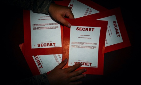 Secret cover sheets are handled by an intelligence analyst with the 169th Operations Support Squadron at McEntire Joint National Guard Base, S.C., in 2015.