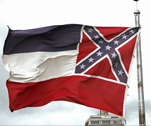 A Mississippi state flag flies outside the capitol in Jackson, Miss., Thursday, June 25, 2020.