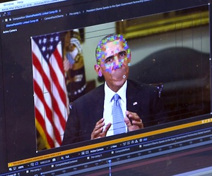 This image made from video of a fake video featuring former President Barack Obama shows elements of facial mapping used in new technology that lets anyone make videos of real people appearing to say things they've never said.
