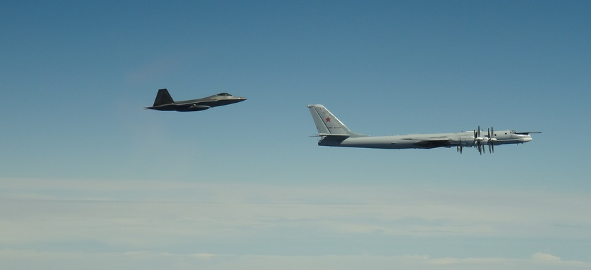 An F-22 Raptor assigned to Joint Base Elmendorf-Richardson, in Alaska, intercepts a Russian Tu-95 Bear on June 9, 2020.