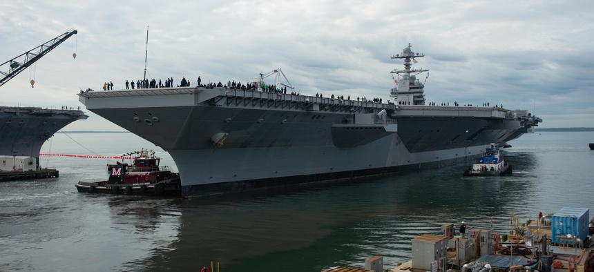Tugs direct USS Gerald R. Ford (CVN 78) as it gets underway. Ford departed Huntington Ingalls Industries-Newport News Shipbuilding, Va., on Oct. 25, 2019.