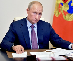 Russian President Vladimir Putin chairs a meeting of Pobeda (Victory) organizing committee via teleconference at the Novo-Ogaryovo residence outside Moscow, Russia, Thursday, July 2, 2020.