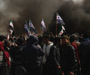 Syrians block main highway in Neyrab, Sunday, March 15, 2020 as they protest agreement on joint Turkish and Russian patrols in northwest Syria.