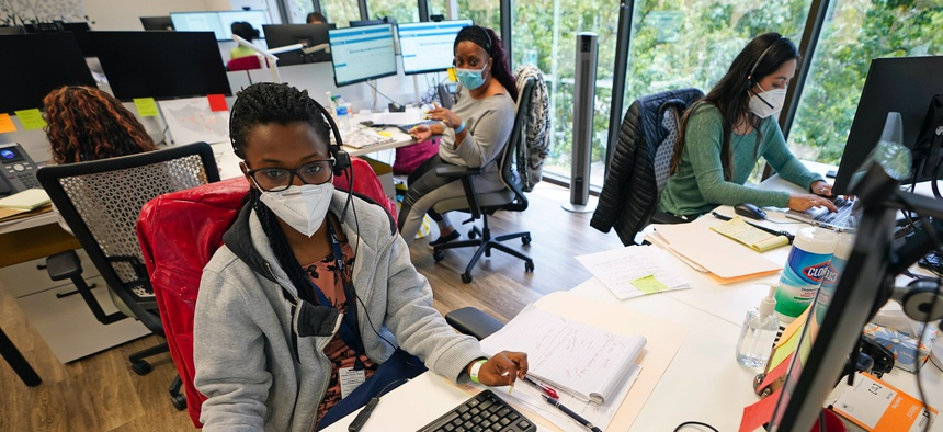 Contact tracers, from left to right, Christella Uwera, Dishell Freeman and Alejandra Camarillo work at Harris County Public Health contact tracing facility Thursday, June 25, 2020, in Houston.