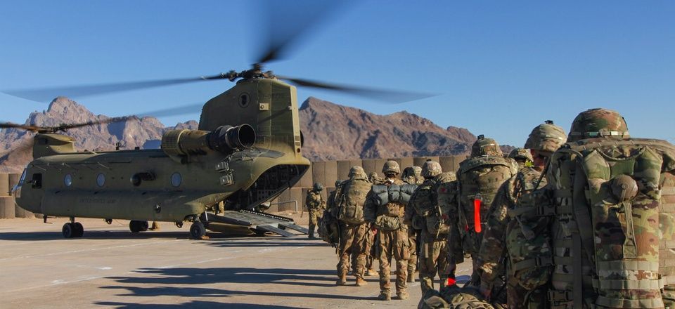 Iowa National Guard and 10th Mountain Division troops load onto a Chinook helicopter to head out and execute missions across the Combined Joint Operations Area-Afghanistan in January 2019.