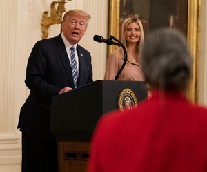 President Donald Trump speaks to CEO of J.D. Clark Professional Services Tisa Clark during an event about the Paycheck Protection Program in April.