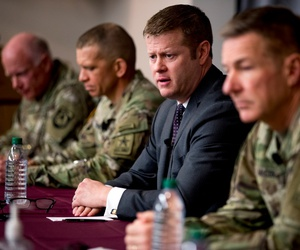 Secretary of the Army Ryan McCarthy, center, accompanied by Col. Darrin Cox, left, Sgt. Maj. Michael Grinston, second from left, and Gen. James McConville, Chief of Staff of the Army, speaks at a news conference at U.S. Army Medical Research and Developme