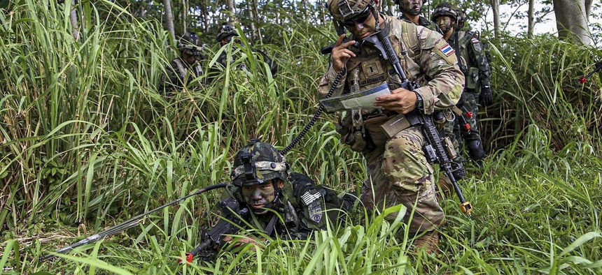 U.S. and Thai soldiers train together at Kahuku Training Area, Hawaii, July 12, 2020, during Lightning Forge, an exercise designed to achieve interoperability with allies.