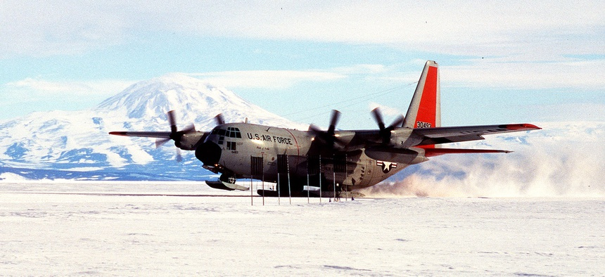 A U.S. Air Force LC-130 Hercules from the New York Air National Guard's 109th Airlift Wing touches down near McMurdo, Antarctica. The first plane landed there 50 years ago.
