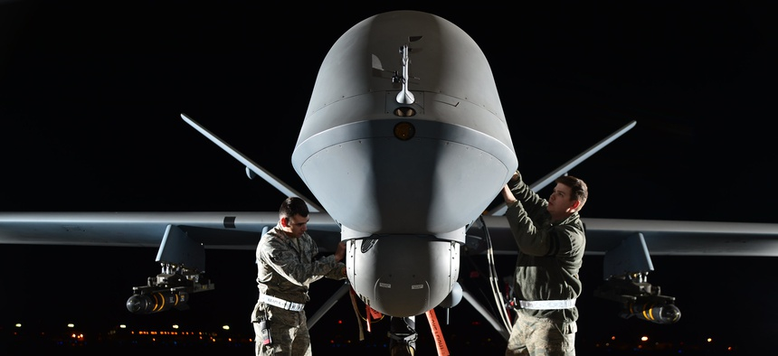 Airmen prepare an MQ-9 Reaper for flight during a 2014 exercise at Creech Air Force Base, Nevada.
