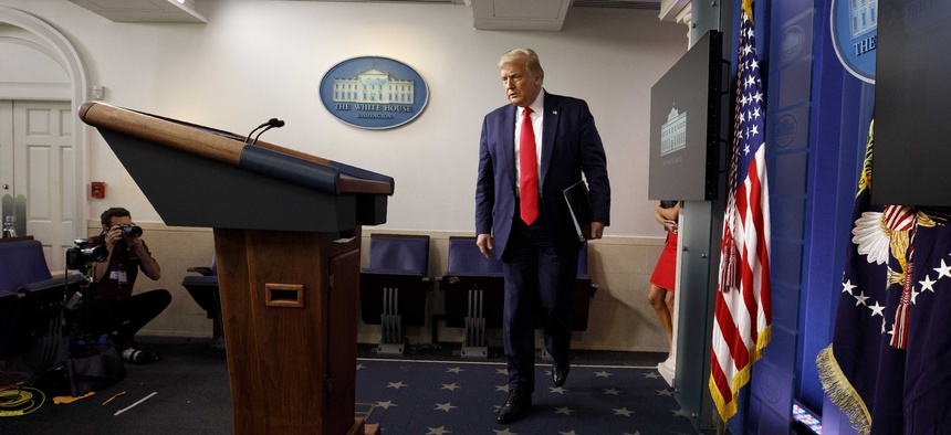 President Donald Trump arrives for a news conference at the White House, Thursday, July 23, 2020, in Washington.