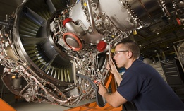 A Pratt & Whitney employee works on an engine in Middletown, Connecticut.