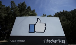 The thumbs up Like logo is shown on a sign at Facebook headquarters in Menlo Park, Calif., Tuesday, April 14, 2020.