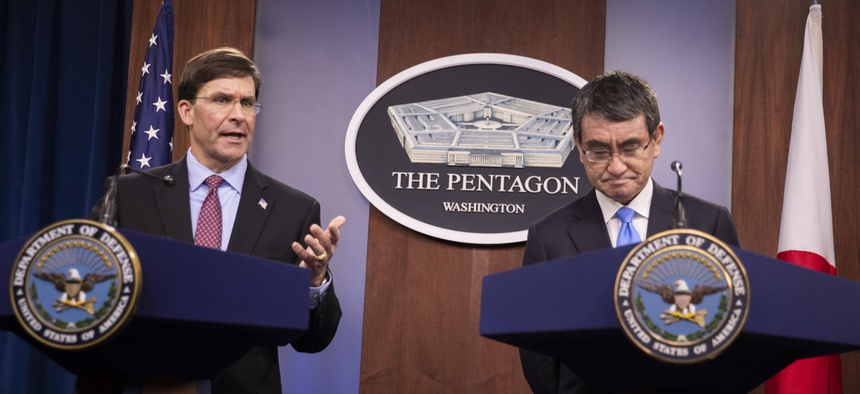 Defense Secretary Mark Esper and Japan's Defense Minister Taro Kono speak during a news conference at the Pentagon in Washington, Tuesday, Jan. 14, 2020.