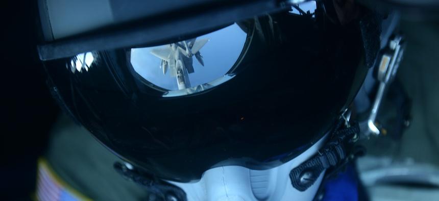 Senior Airman Charlton Hampton refuels an F-15C Eagle from a KC-135 Stratotanker Dec. 23, 2014, near Okinawa, Japan, Dec. 23, 2014.