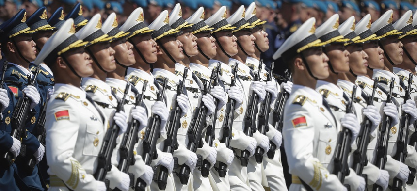 Soldiers from China's People's Liberation Army march toward Red Square during the Victory Day military parade marking the 75th anniversary of the Nazi defeat in Moscow, Russia, Wednesday, June 24, 2020