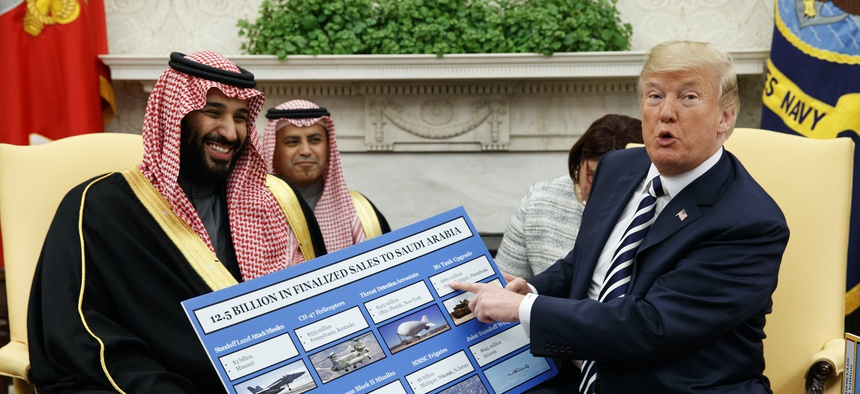 In this March 20, 2018, file photo, President Donald Trump shows a chart highlighting arms sales to Saudi Arabia during a meeting with Saudi Crown Prince Mohammed bin Salman in the Oval Office of the White House in Washington.