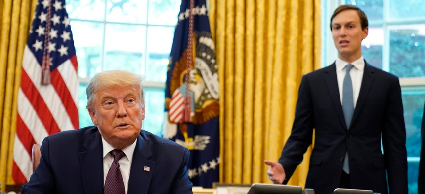 President Donald Trump listens as Jared Kushner speaks in the Oval Office of the White House on Friday, Sept. 11, 2020.